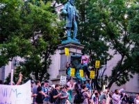 """New York City reviews its """"symbols of hate,"""" removes only one"""